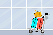 Suitcases on airport and luggage trolley. Travel bag. Summer time. Holidays. Vacation trip. Rest. Windows.
