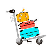 Suitcases on airport luggage trolley. Travel bag. Summer time. Holidays. Vacation trip. Rest