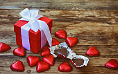 Valentine's day greeting card, red gift box and chocolate heart