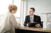 happy Boss businessman talking about report with woman employee and sign signature in document on desk in office room