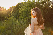 Fine Art Portrait of a beautiful bride in a summer garden