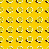 Food pattern with lemons on yellow paper background. Top view.