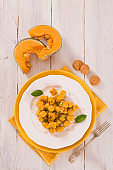 Pumpkin gnocchi with grated amaretti cookies.