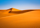 Amazing view of sand dunes in the Sahara Desert. Location: Sahara Desert, Merzouga, Morocco. Artistic picture. Beauty world.