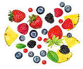 "Summer Background with  fresh fruits and mixed berries isolated on white background. Strawberry, Pineapple, blackberry, blueberry, cranberry, mint leaf.  Flat lay. Food concept.""n"