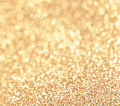 """Golden abstract Christmas Background with   sparkling glittering lights. Shiny festive New Year greeting card""""n"""