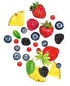 Fresh berries isolated on white background, top view. Strawberry, Raspberry, Blueberry and Mint leaf, flat lay
