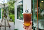 Iced black coffee with orange juice.