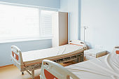 Modern hospital room. Hospital bed in clean and modern hospital. Interior of empty hospital ward.