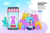 Shopping online concept. Colorful paper shopping bags in shopping trolley on bright background. Webpage, app design. flat vector illustration.