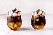 Glasses of Homemade Cold Brew Coffee to Drink for Breakfast Summer Beverage with Ice Cubes Decorated with Strawberry and Chocolate Horizontal