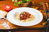 Spaghetti bolognese with tomato sauce, minced meat and grated parmesan cheese. Italian pasta.