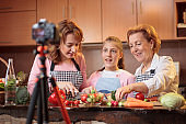 Multi-generational female family of influencers creating vlog about healthy eating
