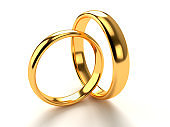 Wedding gold rings lie in each other