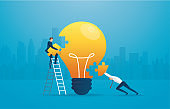 businessman putting the puzzle lightblub together. creative concept. vector illustration EPS10