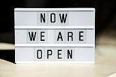 White lightbox with greeting text message Now we are open. End of quarantine concept.