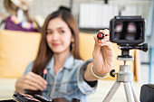 Beauty blogger show red lipstick to live video camera