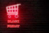 Black Friday text from an electric lamp on the wall