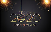 Golden numbers 2020 and christmas ball line art Happy New Year of glitter gold fireworks in black color background. Vector golden glittering text and 2020 numbers for holiday greeting card