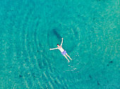 Aerial View Man Floating in Water and Relaxing