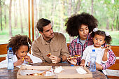 Family eating pizza outdoor together