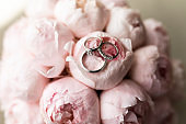 Wedding rings at the wedding bouquet