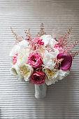 Beautiful wedding bouquet on the wooden floor.