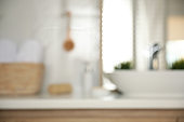 Blurred view of light modern bathroom interior