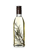 Cooking oil with rosemary in glass bottle