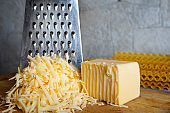 A piece of cheese grated on a handmade grater
