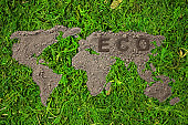 Concept ecology. World map, globe from the soil on natural green background. Earth day