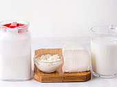 Fermented dairy products such as kefir and cheese on a white background. Copy space