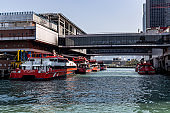 Hong Kong - Macau Ferry Terminal at Victoria Habour. High-speed crafts are berthed at pier. All the sailing services between HK and Macau have be suspended because of COVID-19 travel alert.
