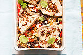 Chermoula roasted tuna with tomatoes, aubergine, red peppers, beans, raisins and almonds