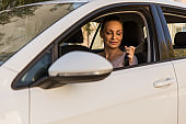 Smiling woman about to put her seat belt on