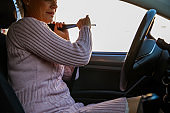 Responsible woman adjusting her seat belt