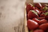 Juicy strawberries in the wooden basket