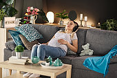 Pregnant woman giving herself a moment of enjoyment with her favorite tune