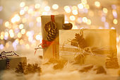 Artistic shot of three light brown gifts for Christmas