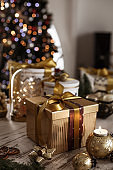 Close up of beautifully wrapped Christmas present on a rustic wooden table