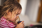 Breathing device on girl's face to recover from respiratory illness