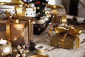 Arrangement of Christmas presents and decorations on rustic wooden table