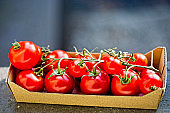 Summer cherry vine tomatoes in paper box