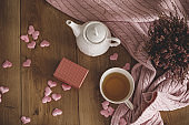 A warm cup of tea, love hears and a small gift box for Valentine's day