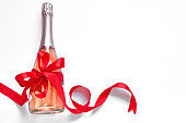 Champagne bottle with red bow ribbon