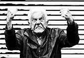 Furious senior man grimaces, shaking fists. Black-and-white image