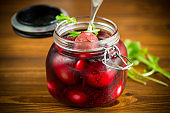 marinated chicken eggs in beetroot marinade in a glass jar