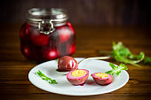 marinated chicken eggs in beetroot marinade in a plate