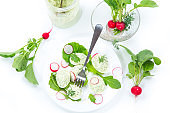 boiled stuffed eggs with green cheese filling with arugula leaves and radish