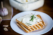fried toast bread with garlic curd filling on a table
